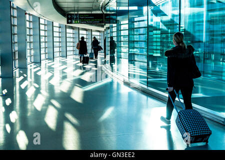 Dublin Airport Terminal One passengers with hand luggage arrivals, Ireland - Stock Photo