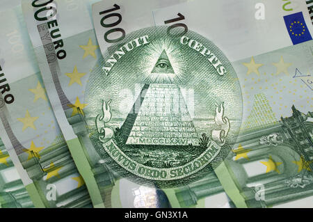 Element of the image of United States one-dollar bill, pyramid, Eye of Providence above one hundred euros banknotes. - Stock Photo