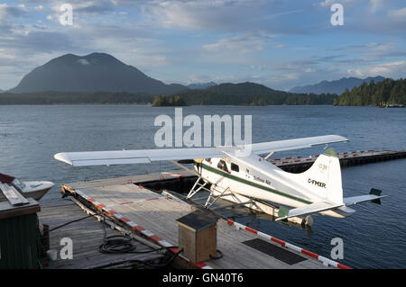 Tofino, Canada: Bush plane at the Tofino dock on Clayoquot Sound. In thge distance is Lone Cone Mountain on Meares - Stock Photo