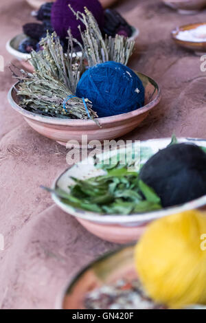 close up of a table with natural products used to dye clothing in traditional Peruvian styles and colors - Stock Photo