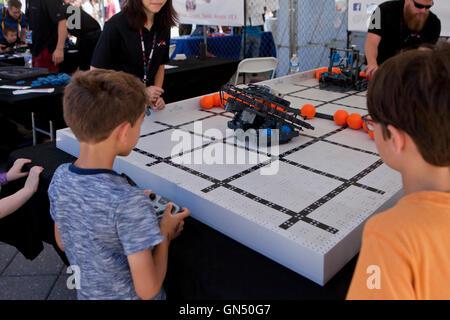 Schoolchildren learning about  robotics at Maker Faire - Washington, DC USA - Stock Photo