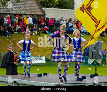 Girls in kilted skirts performing at the Highland Dancing competition, Ceres Highland Games, Ceres, Scotland, United - Stock Photo