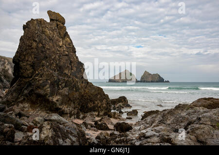 The beach at Holywell Bay on the coast of Cornwall, England. View looking out to sea and the rocks known as Gull - Stock Photo