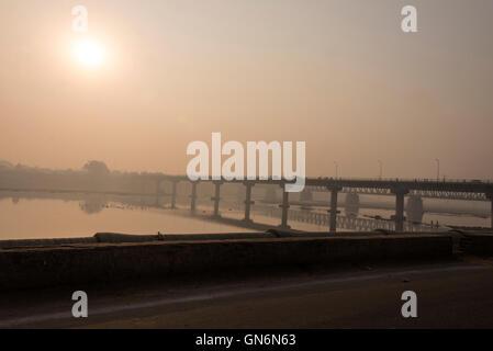 The traffic carrying Yamuna bridge across the Yamuna River in Agra, Uttar Pradesh. India - Stock Photo
