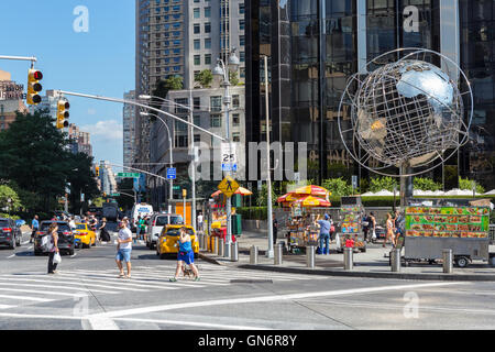 A view up Broadway from Columbus Circle in New York City. - Stock Photo