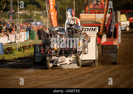 danish tractor pulling team competing with 4 V8 supercharged engines - Stock Photo