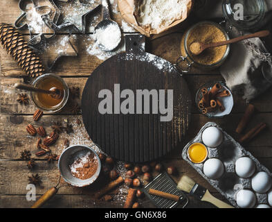 Christmas holiday cooking and baking ingredients with board in center - Stock Photo