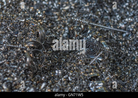 Close shot of metal turnings / industrial swarf from CNC machining operations. Industrial waste, metal waste. - Stock Photo