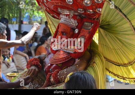 Theyyam-it is a ritual dance popular in north Kerala or the erstwhile Kolathunadu. Theyyam incorporates dance, mime - Stock Photo