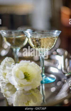 Champagne glasses on a silver tray - Stock Photo