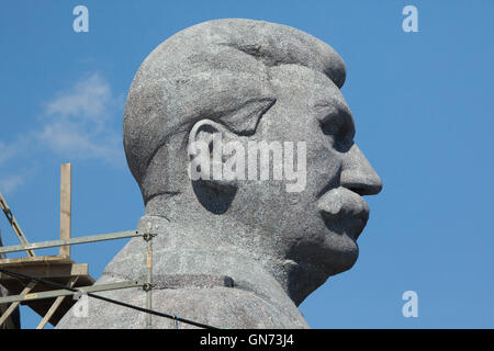 Huge head of Soviet dictator Joseph Stalin rising over Letna Park in Prague, Czech Republic, during the Czech Television - Stock Photo