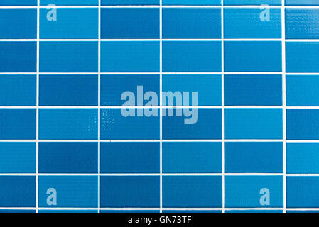 A blue tiled background with relatively small tiles - Stock Photo