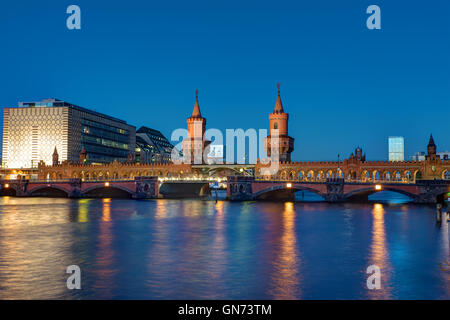 The famous Oberbaumbruecke in Berlin at night - Stock Photo