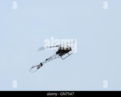 Agusta Bell Sioux AH Mk1 - XT131 (G-CICN) Flying over Dunsfold Airfield - Stock Photo