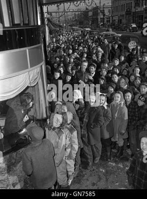 Children on line for the movies, 1946, in Madison Wisconsin. - Stock Photo