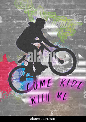 Come ride with me, wall graffiti image of a bicycle stunt - Stock Photo