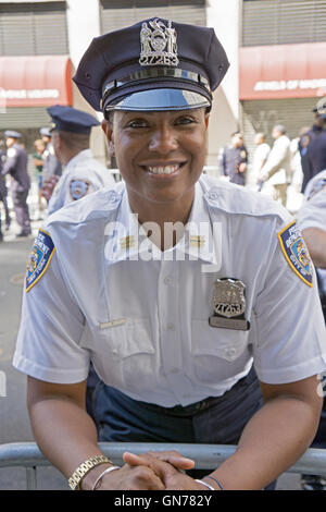 A beautiful policewoman on patrol at the 2016 Pakistan Day Parade on Madison Ave,. in Manhattan, New York City. - Stock Photo