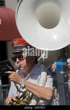 A man in the Yonkers Military Band playing the tuba in the 2016 Pakistan Day Parade in New York City. - Stock Photo