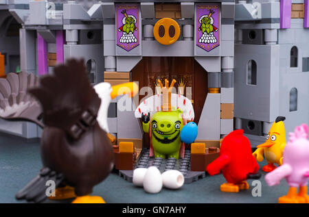 Tambov, Russian Federation - July 20, 2016 King Pig with blue egg standing at King Pigs Castle entrance versus Lego - Stock Photo