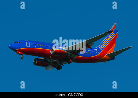 Southwest Airlines Boeing 737-7H4 (registration N265WN) approaches San Francisco International Airport (SFO) over - Stock Photo