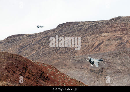 Two McDonnell-Douglas F-15C Eagles fly low level through the Jedi Transition, R-2508 complex, Star Wars Canyon / - Stock Photo