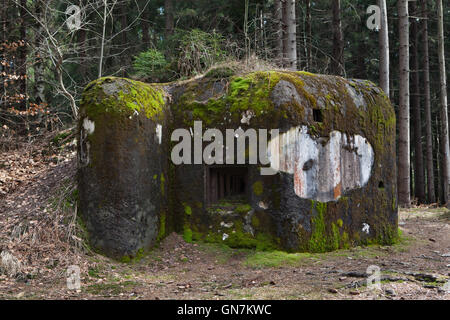 Abandoned pillbox model 37 once used to be a part of the Czechoslovak border fortifications located on the road - Stock Photo