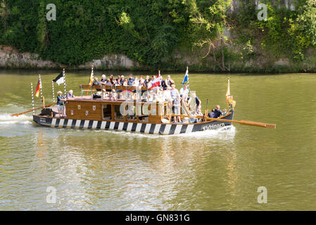 ULM, GERMANY - AUGUST 13: Tourists on a historic raft on the Danube river in Ulm, Germany on August 13, 2016. - Stock Photo