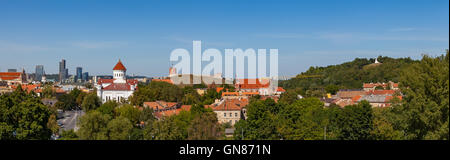 Panoramic cityscape of Vilnius old town and Gediminas hill, Lithuania - Stock Photo