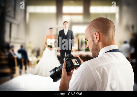 Professional photographer in a wedding - Stock Photo