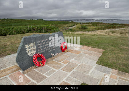 Stone memorial at Noirmont Point, St. Brelade, Jersey for the people of Jersey who died during the second world - Stock Photo