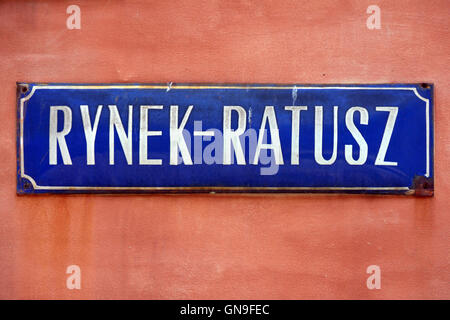 Street sign of Rynek Ratusz on Market Square in the Old Town of Wroclaw in Poland. - Stock Photo