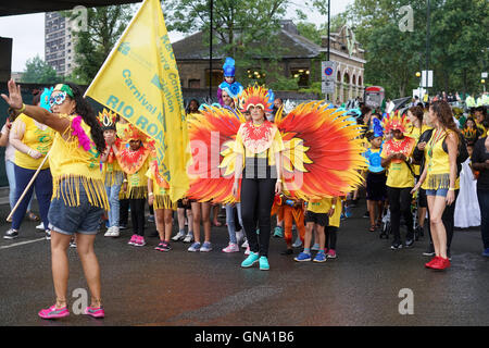 London,England,UK, 28th Aug 2016 : Large crowds attend the parade on Children's Day with many colourful costumes - Stock Photo