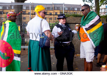 Friendly Policewoman talks to revelers at the 50th Notting Hill Carnival, London, August 29 2016. Credit:  wayne - Stock Photo
