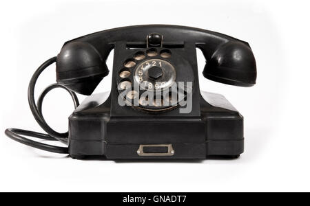 Old black phone with dust and scratches - Stock Photo