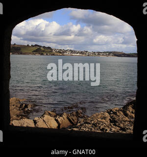 Looking out of the window of the ruined Little Dennis Castle towards St Mawes, Cornwall, England, UK. - Stock Photo