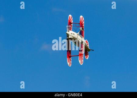 Christen Eagle II G-OEGL in flight over Breighton Airfield - Stock Photo