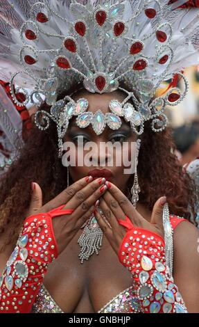 Dancers performing in the Monday parade during the second and final day of the Notting Hill Carnival, west London. - Stock Photo