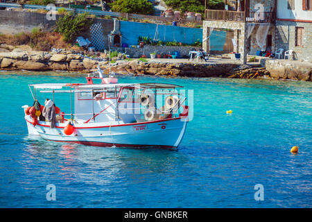 OURANOPOLIS, GREECE - JUNE 05, 2009: Vintage fishing boat in bay near Athos mount - Stock Photo