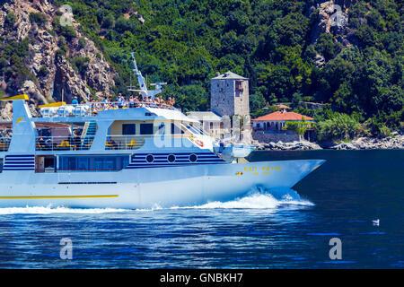 OURANOPOLIS, GREECE - JUNE 05, 2009: Touristic ship near Port Dafna, gate to Athos monk republic - Stock Photo