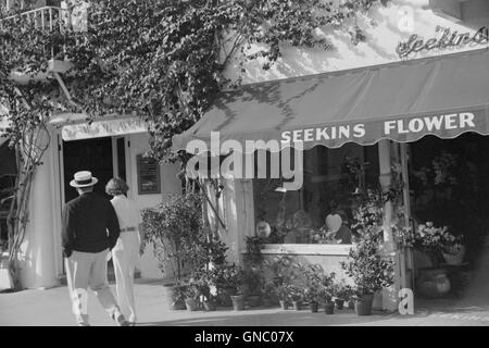 Couple Walking Along Worth Avenue, Palm Beach, Florida, USA, Marion Post Wolcott for Farm Security Administration, - Stock Photo