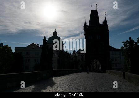 Silhouette skyline during an early sunrise of some of the surrounding buildings including the Old Town Bridge tower - Stock Photo
