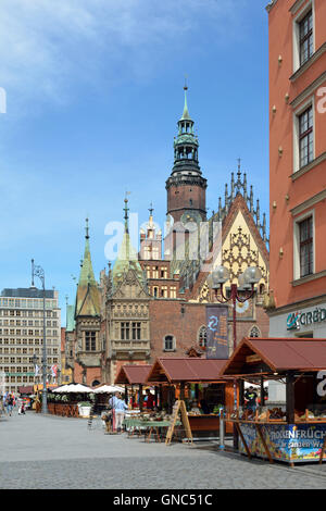 People from the Old Town Hall on Market Square in the Old Town of Wroclaw in Poland. - Stock Photo