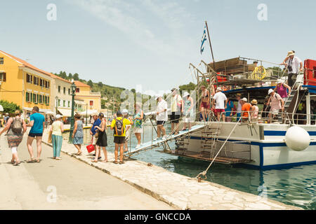 Gaios, Paxos, Greece - tourists arriving in Gaios - the main port on Paxos, one of the Ionian Islands - by boat - Stock Photo