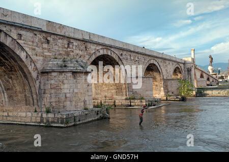 The Stone Bridge is a bridge across the Vardar River in Skopje, the capital of the Republic of Macedonia. - Stock Photo