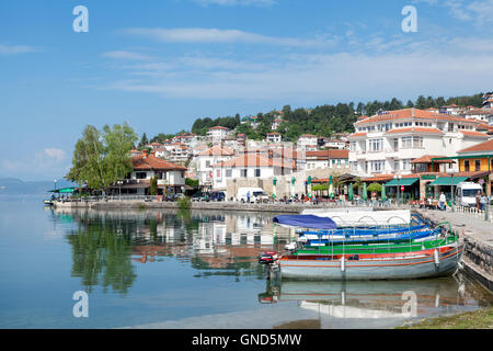 Ohrid, Macedonia - May 9, 2016 : Fishing boats on the Lake Ohrid with old town in the background. - Stock Photo