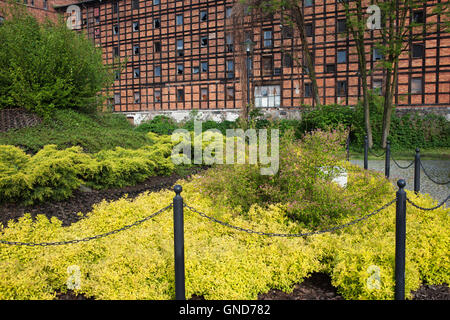 Rother Mills and garden on Mill Island, old industrial building in city of Bydgoszcz, Poland - Stock Photo