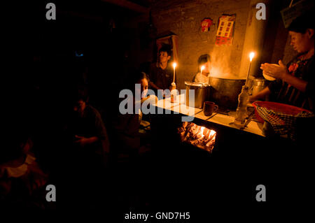 Maya indigenous family live with candle in Caserio Panuca in Solola department Guatemala. - Stock Photo