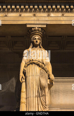 A terracotta caryatid above the crypt of the Victorian Greek Revival style St Pancras New Church in the Euston Road, - Stock Photo