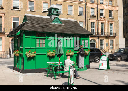 Cabmens shelter, people buy food from a converted nineteenth century cabman's shelter in Russell Square, Bloomsbury, - Stock Photo