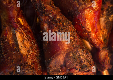 Crispy and juicy barbecue turkey legs on catering platter - Stock Photo